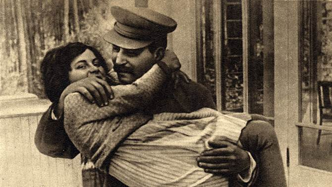FILE - In this undated photo provided by Icarus Films, shows Soviet dictator Josef Stalin with his daughter Svetlana Alliluyeva. Newly declassified files show the FBI was gathering details from informants on how  Alliluyeva's arrival in the United State was affecting international relations after her high-profile defection in 1967.  Alliluyeva, or Lana Peters, Stalin's only daughter, died in a Wisconsin nursing home in 2011.  She was 85. (AP Photo/Courtesy Icarus Films, File)