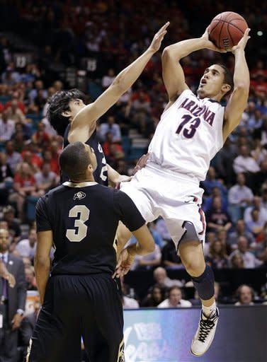 No. 18 Arizona beats Colorado 79-69 at Pac-12