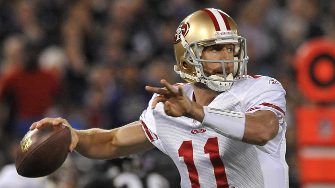 San Francisco 49ers quarterback Alex Smith throws during the first half of an NFL football game against the Baltimore Ravens in Baltimore on Thursday, Nov. 24, 2011. (AP Photo/Gail Burton)