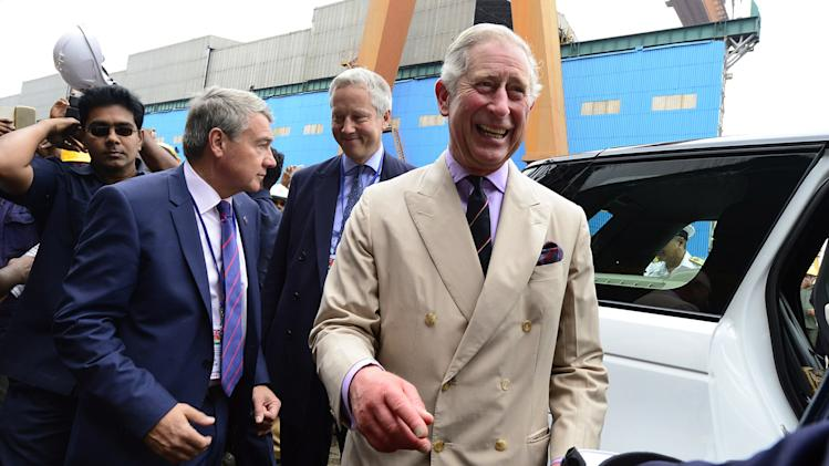 Britain's Prince Charles smiles as he interacts with officials during a visit to a shipyard to see India's first Indigenous Aircraft Carrier INS Vikrant in Kochi, India, Tuesday, Nov. 12, 2013. Charles and his wife Camilla, the Duchess of Cornwall, are on a nine-day visit to India. (AP Photo)