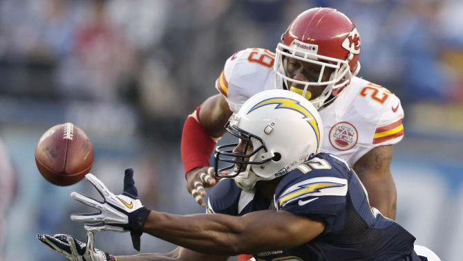 San Diego Chargers receiver Seyi Ajirotutu makes a diving catch in front of Kansas City Chiefs strong safety Eric Berry during the first half of an NFL football game Thursday, Nov. 1, 2012, in San Diego. (AP Photo/Greg Bull)
