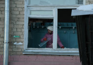 In this photo provided by Chelyabinsk.ru a woman cleans away glass debris from a window after a meteorite explosion over Chelyabinsk region on Friday, Feb. 15, 2013. A meteor exploded in the sky above Russia on Friday, causing a shockwave that blew out windows injuring hundreds of people and sending fragments falling to the ground in the Ural Mountains. The Russian Academy of Sciences said in a statement hours after the Friday morning fall that the meteor entered the Earth&#39;s atmosphere at a speed of at least 54,000 kph (33,000 mph) and shattered about 30-50 kilometers (18-32 miles) above ground. The fall caused explosions that broke glass over a wide area. (AP Photo/ Yevgenia Yemelyanova, Chelyabinsk.ru)