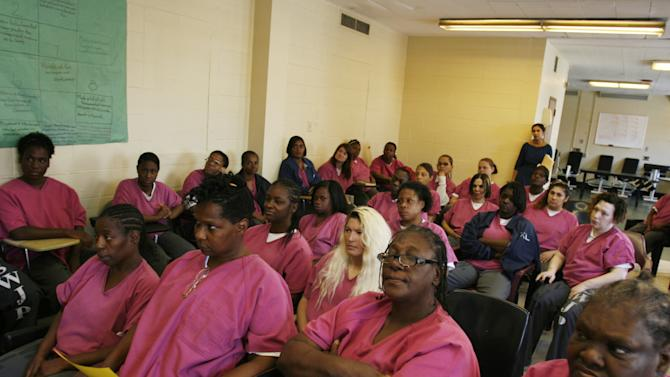 Tiffany Schipitz, center, with blond hair, sits with other female inmates during a Prostitution Anonymous meeting at the Cook County jail in Chicago, on Friday, Aug. 16, 2013. Schipitz, 35, says she was coerced into prostitution and stayed because of a drug addiction. (AP Photo/Martha Irvine)