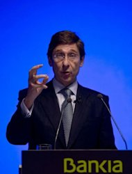 The new president of Spain&#39;s fourth-biggest bank, Bankia, Jose Ignacio Goirigolzarri speaks during a press conference in Madrid. Goirigolzarri said he was confident of receiving from the government 19 billion euros ($24 billion) in the largest bank bailout in the country&#39;s history