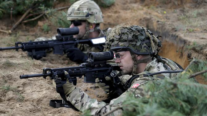 """Danish soldiers take part in a live fire exercise in a tactical environment ahead of the """"Silver Arrow"""" drill in Adazi training field"""