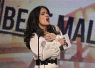 Actress Salma Hayek presents the award for best male lead at the 2013 Film Independent Spirit Awards in Santa Monica, California February 23, 2013. REUTERS/David McNew