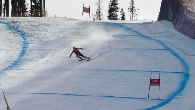Erik Guay of Canada, speeds down the course during the men's World Cup downhill ski race in Beaver Creek, Colo., on Friday, Nov. 30, 2012.  (AP Photo/Nathan Bilow)