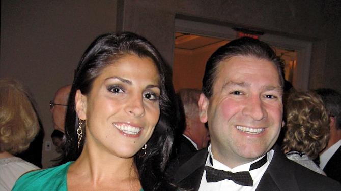 "In this May 16, 2011 photo Dr. Scott Kelley, right, and his wife Jill Kelley pose for a photo in Tampa, Fla. Jill Kelley's attempt to climb the Tampa social ladder _ the rungs of which included some high-ranking military officials _ has come to an ignominious halt. Accounts of lavish parties at her bayfront mansion have been replaced by reports of her family's financial woes and other dirty laundry, and claims that she traded on her acquaintance with David Petraeus to try to further lucrative business dealings. Now, even her ""Friends of MacDill"" Air Force base access pass has been unceremoniously revoked. (AP Photo/Tampa Bay Magazine) MANDATORY CREDIT"