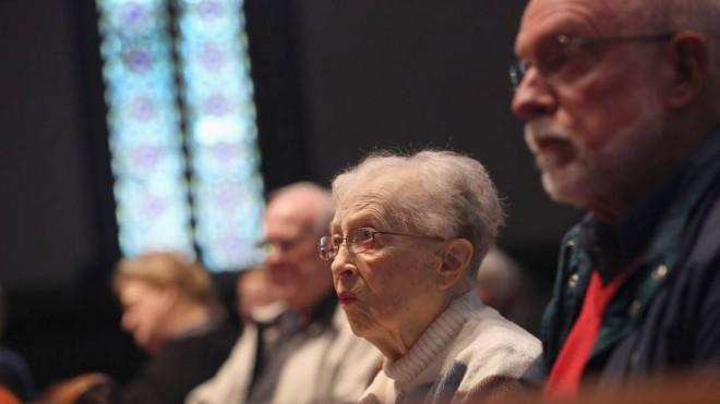 Congregation members attend a Sunday service at the First Presbyterian Church in Warren, Ohio, days before the 2012 election.