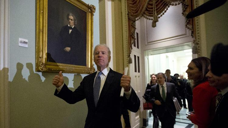 Vice President Joe Biden gives two thumbs up following a Senate Democratic caucus meeting about the fiscal cliff on Capitol Hill on Monday, Dec. 31, 2012 in Washington. (AP Photo/Alex Brandon)