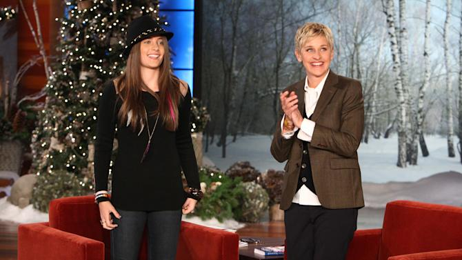 "In this Dec. 13, 2011 photo released by Warner Bros., talk show host Ellen DeGeneres, right, welcomes Paris Jackson, daughter of the late pop star Michael Jackson during a taping of ""The Ellen DeGeneres Show"" in Burbank, Calif.  The episode will air on Thursday. (AP Photo/Warner Bros., Michael Rozman)"