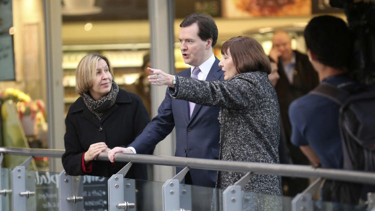 Britain's Chancellor of the Exchequer George Osborne tours Manchester Piccadilly train Station in Manchester, England with Dyan Crowther, Route Managing Director of Network Rail, left, and Alison Monroe, CEO of HS2, Monday Jan. 28, 2013. The British government on Monday unveiled details of new high-speed rail lines linking London to cities in northern England with trains traveling up to 225 miles an hour (360 kph). The government says the project, known as High Speed 2, will be the first new railway built north of London for more than a century, and will be an economic and environmental boon. But opponents claim the plan is too expensive and will ruin tracts of picturesque countryside. (AP Photo/PA, Christopher Furlong) UNITED KINGDOM OUT  NO SALES  NO ARCHIVE