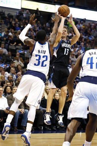 Collison leads balanced Mavs over Wolves 113-98