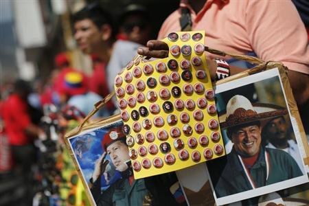Souvenirs bearing images of Venezuela&#39;s President Hugo Chavez are on sale during a rally in Caracas February 27, 2013. REUTERS/Jorge Silva