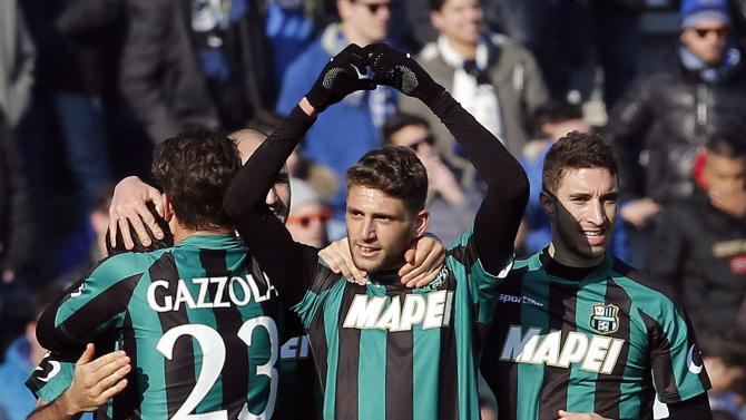 Sassuolo's Berardi celebrates after scoring the third goal against Inter Milan during their Italian Serie A soccer match at the Mapei stadium in Reggio Emilia