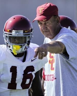 FILE -  In this Aug. 6, 2011, file photo,  Southern California assistant head coach Monte Kiffin, right, talks with cornerback Anthony Brown during NCAA college football practice in Los Angeles.  The Dallas Cowboys hired Kiffin as the replacement for Rob Ryan, the team announced on Friday, Jan. 11, 2012. Kiffin hasn't coached in the NFL since ending a 13-year run in Tampa in 2008. He spent the past few years coaching in college with his son, Lane Kiffin, at Tennessee and Southern California. (AP Photo/Mark J. Terrill, FIle)