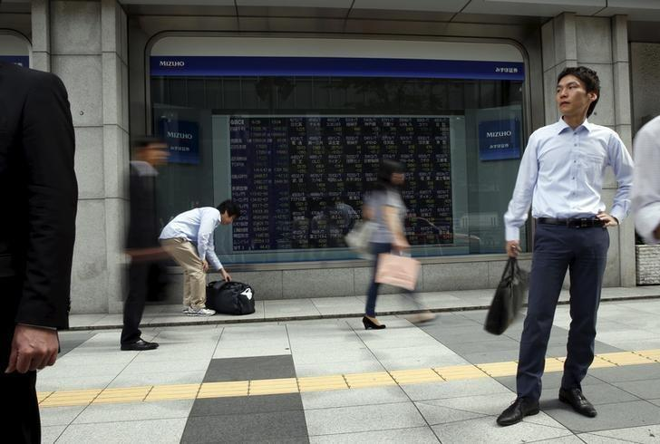Asian shares extend October rally; dollar slips