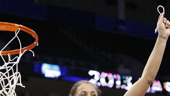 Louisville's Shoni Schimmel cuts down a piece of the net after her team defeated Tennessee during their regional final game in the women's NCAA college basketball tournament in Oklahoma City, Tuesday, April 2, 2013. (AP Photo/Alonzo Adams)