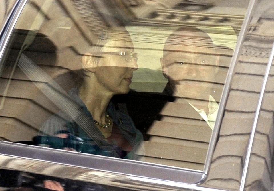 RETRANSMISSION FOR ALTERNATE CROP - Rep. Gabrielle Giffords, D-Ariz., sits in a car with her husband Mark Kelly as she leaves the U.S. Capitol after she appeared on the House floor to vote on debt legislation in Washington, Monday, Aug. 1, 2011. (AP Photo/Susan Walsh)