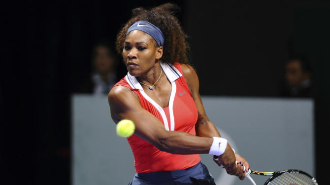 Serena Williams of the US returns a shot to Na Li of China, during their tennis match on the second day of the WTA championship in Istanbul, Turkey, wednesday, Oct. 24, 2012. (AP Photo)