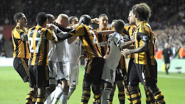 Swansea City and Hull City players scuffle during their English Premier League soccer match at the Liberty Stadium in Swansea, Wales, December 9, 2013. REUTERS
