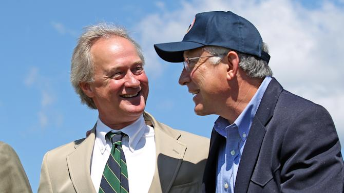 U.S. Interior Secretary Ken Salazar, right, walks with his arm around Rhode Island Gov. Lincoln Chafee, left, prior to a press conference in North Kingstown, R.I., Wednesday, Aug. 17, 2011. Salazar announced that the federal government will formally accept applications to develop wind farms off the Rhode Island coast. (AP Photo/Stew Milne)