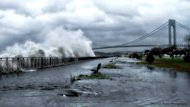 Waves crash ashore near the Verrazano Bridge in Brooklyn, N.Y., ahead of Hurricane Sandy&#39;s landfall on Monday, Oct. 29.