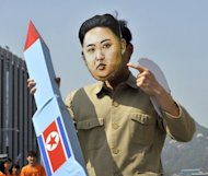 A South Korean activist wearing a mask of North Korean leader Kim Jong-Un holds a mock missile during a rally in Seoul in April. North Korea has said it will carry out a new rocket launch this month, following a failure in April that was condemned by the international community as a disguised ballistic missile test