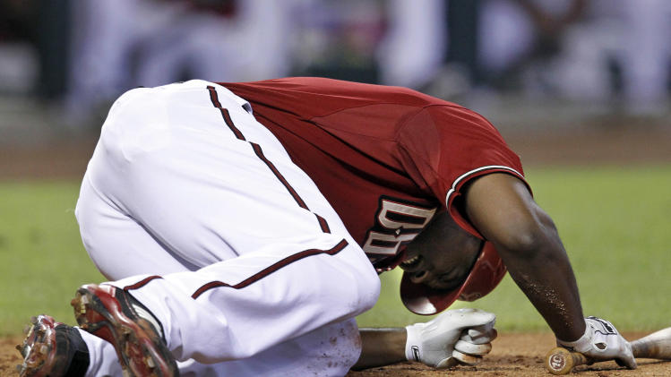 Arizona Diamondbacks' Justin Upton reacts after being hit by a pitch in the sixth inning against the Washington Nationals during an MLB baseball game on Sunday, June 5, 2011, in Phoenix. Nationals pitcher Jason Marquis was ejected by home plate umpire Rob Drake for hitting Upton with the pitch. (AP Photo/Arizona Republic, David Kadlubowski)   MARICOPA COUNTY OUT; NO SALES