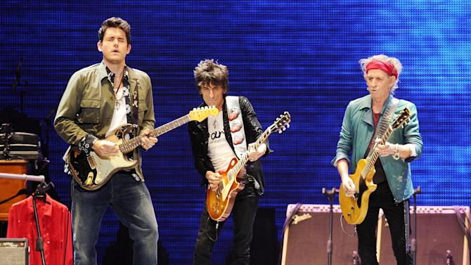 Guitarist John Mayer, left, performs with Ronnie Wood and Keith Richards, right, of The Rolling Stones at the Prudential Center in Newark, NJ on Saturday, Dec. 15, 2012. (Photo by Evan Agostini/Invision/AP)