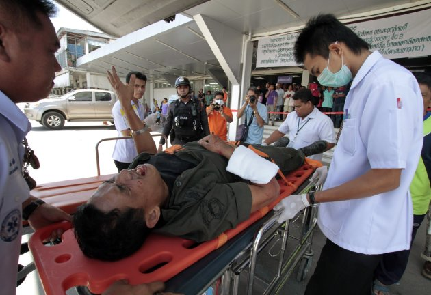 Police officer who was injured in a bomb attack by suspected Muslim militants, is rushed to a hospital in Yala province