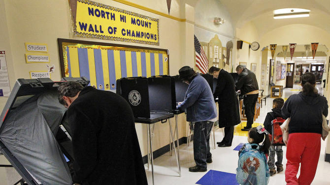 Voters cast their ballots at North Hi Mount Elementary School as children make their way to class Tuesday March 4, 2014 Fort Worth, Texas. Texas is holding the nation's first primary election Tuesday with a political free-for-all in Republican races that could push the state further right, though Democrats are calling it the next big battleground on the electoral map. (AP Photo/The Fort Worth Star-Telegram, Ron Jenkins) MAGS OUT; (FORT WORTH WEEKLY, 360 WEST); INTERNET OUT
