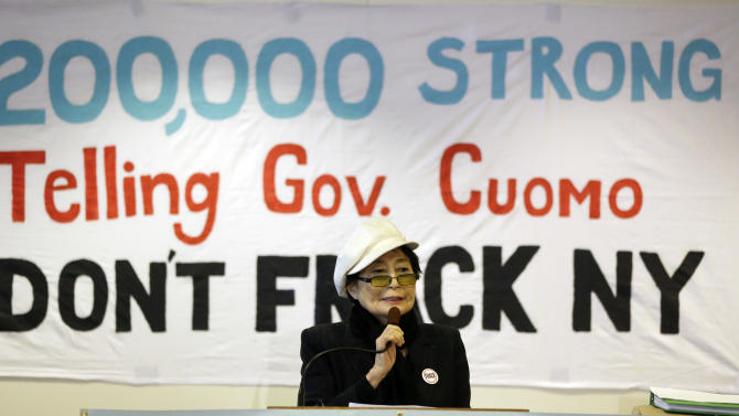 """Yoko Ono speaks during a news conference opposing hydraulic fracturing on Friday, Jan. 11, 2013, in Albany, N.Y. Environmental, health and community groups opposed to shale gas drilling and hydraulic fracturing, or """"fracking,"""" say they collected more than 200,000 comments during an intense 30-day effort featuring online coaching and comment-writing workshops at churches, community centers, food co-ops, coffee shops and holiday house parties from New York City to Buffalo. (AP Photo/Mike Groll)"""