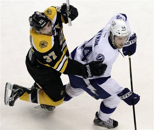 Pouliot lifts Bruins to 5-2 win over Lightning