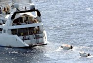 "File photo of the luxury sailing ship ""Le Ponant"" being held hostage by Somali pirates off the Somalian coast. Six Somalis go on trial in a Paris court on May 22, 2012 charged with taking the crew of 30 hostage in the emerald, pirate-infested waters of the Gulf of Aden in 2008"
