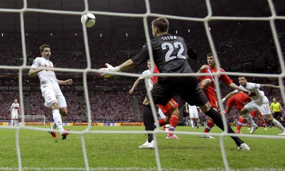 Russia's Alan Dzagoyev, second right,  scores  a goal during the Euro 2012 soccer championship Group A match between Poland and Russia in Warsaw, Poland, Tuesday, June 12, 2012. (AP Photo/Matt Dunham)