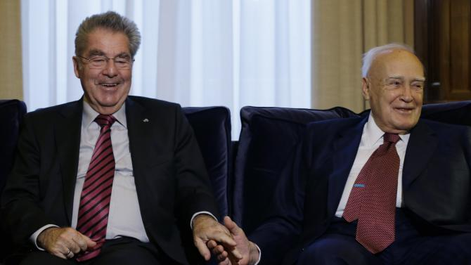 Greece's President Karolos Papoulias, right, and his Austrian counterpart Heinz Fischer laugh during their meeting at the Presidential Palace in Athens, Thursday, Oct. 23, 2014. Fischer's two-day visit to Greece is the first of an Austrian President in seven years. (AP Photo/Thanassis Stavrakis)