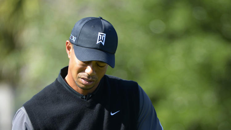 Tiger Woods reacts after hitting his tee shot on the first hole during the first round of the Arnold Palmer Invitational golf tournament in Orlando, Fla., Thursday, March 21, 2013.(AP Photo/Phelan M. Ebenhack)