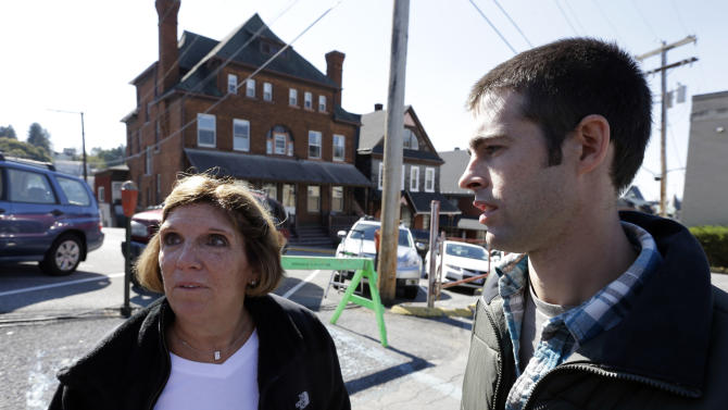 Gayle Barnes, left, and Joshua Harper, jurors in Jerry Sandusky's trial, speak with members of the media outside the Centre County Courthouse in Bellefonte, Pa., Tuesday, Oct. 9, 2012. Former Penn State University assistant football coach Jerry Sandusky was sentenced to at least 30 years in prison, effectively a life sentence, in the child sexual abuse scandal that brought shame to Penn State and led to coach Joe Paterno's downfall. (AP Photo/Matt Rourke)