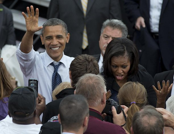 President Barack Obama and first lady Michelle Obama greet people in the crowd during a campaign event at University of Iowa, Friday, Sept. 7, 2012, in Iowa City, Iowa. (AP Photo/Carolyn Kaster)