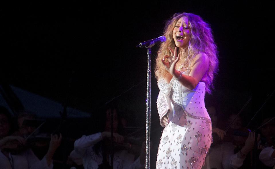 Mariah Carey performs in Central Park during the All-Star Charity Concert to benefit Hurricane Sandy victims on Saturday, July 13, 2013 in New York. (Photo by Carlo Allegri/Invision/AP Images)