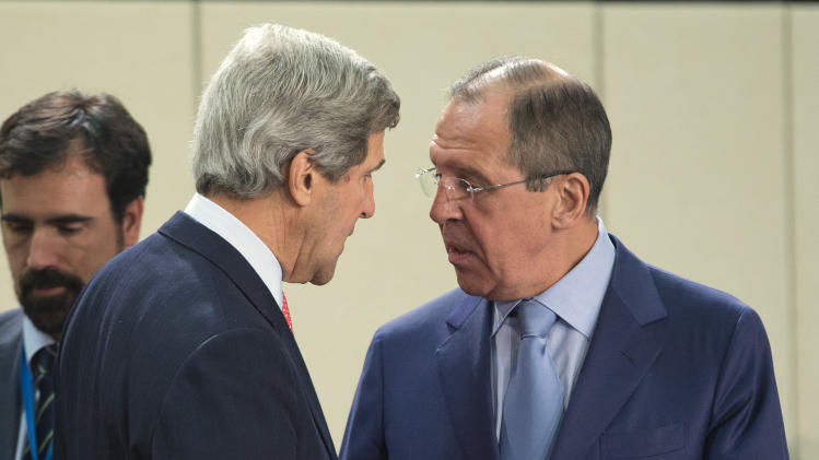 U.S. Secretary of State John Kerry, left, speaks with Russian Foreign Minister Sergei Lavrov before the start of the NATO- Russia Council meeting at NATO headquarters on Tuesday, April 23, 2013, in Brussels, Belgium.  (AP Photo/Evan Vucci, Pool)
