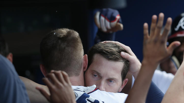 Atlanta Braves' Chris Johnson, right, gets a hug from Freddie Freeman after hitting a two-run home run in the second inning of a baseball game against the Miami Marlins Thursday, July 24, 2014 in Atlanta. (AP Photo)