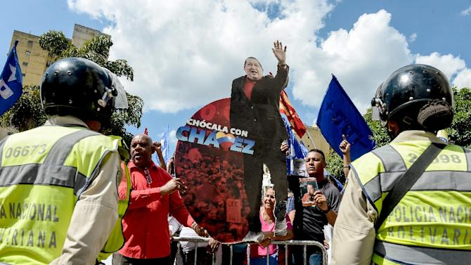 Supporters of Venezuela's late president Hugo Chavez and current President Nicolas Maduro accompany United Socialist Party (PSUV) deputies, outside the Supreme Court of Justice in Caracas on January 7, 2016