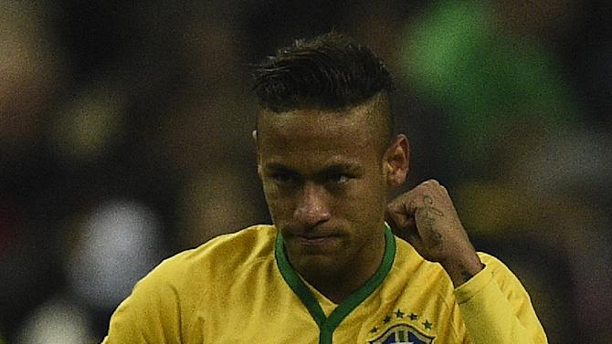 Brazil's Neymar celebrates after scoring a goal during their friendly match against France, at the Stade de France in Saint-Denis, north of Paris, on March 26, 2015
