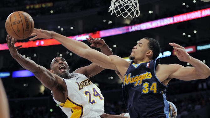 Los Angeles Lakers guard Kobe Bryant, left, puts up a shot as Denver Nuggets center JaVale McGee defends during the first half of an NBA first-round playoff basketball game, Sunday, April 29, 2012, in Los Angeles. (AP Photo/Mark J. Terrill)