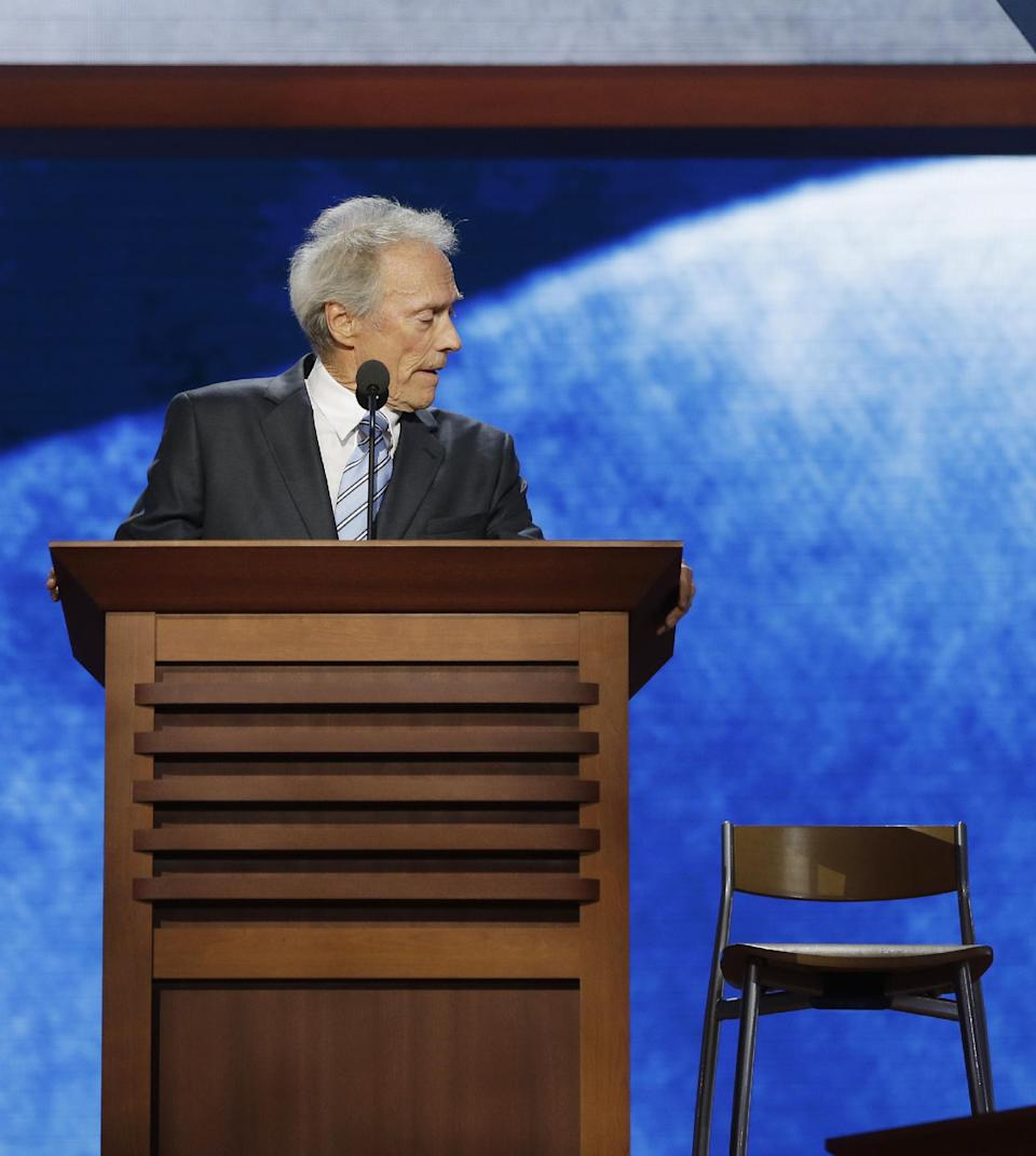 FILE - This Aug. 30, 2012 file photo shows actor Clint Eastwood looking toward an empty chair as he addresses the Republican National Convention in Tampa, Fla. (AP Photo/Charles Dharapak)