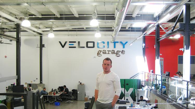 In this May 10, 2012 photo, Stephen Lake from Playfit Mobile stands in the University of Waterloo's VeloCity incubation startup area in Waterloo, Ontario, Canada. Many locals say Research In Motion's decline will in part be absorbed by a thriving startup community in Waterloo, home to more than 800 tech companies and Canada's version of Silicon Valley. (AP Photo/Robert Gillies)