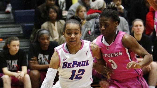 DePaul's Brittany Hrynko drives past Rutgers' Erica Wheeler during the first half in an NCAA college basketball game in Chicago, Tuesday, Feb. 12, 2013. (AP Photo/Charles Cherney)