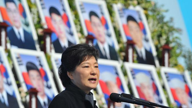 """South Korean President Park Geun-hye delivers a speech during the third anniversary of the sinking of a South Korean naval war ship """"Cheonan,"""" at the National Cemetery in Daejeon, South Korea, March 25, 2013. An explosion ripped apart the 1,200-ton warship, killing 46 sailors near the maritime border with North Korea in 2010. (AP Photo/Kim Jae-hwan, Pool)"""